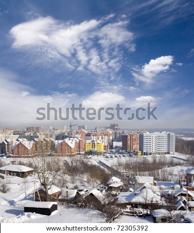 Cityscape of old and new district. Winter town