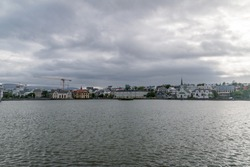 Cityscape of Reykjavik on lake Tjornin in Iceland.