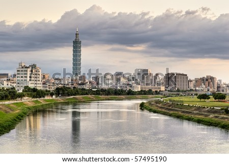 Cityscape of river with famous landmark, the 101 skyscraper, and reflection in Taipei, Taiwan. - stock photo