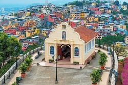 Cityscape of Santa Ana Hill Church with colorful colonial housing, Las Penas district, Guayaquil, Ecuador.
