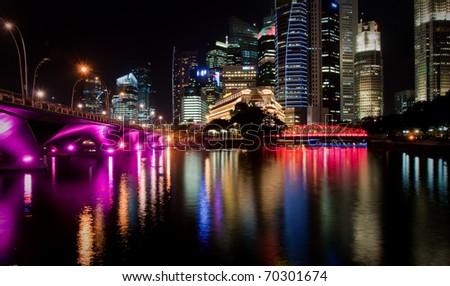 Cityscape of Singapore at night, colorful bridge