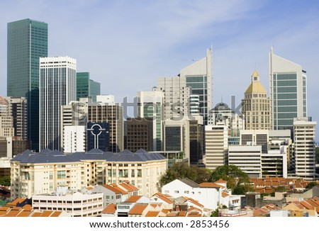 Cityscape of Singapore showing the financial district and shophouses in the foreground