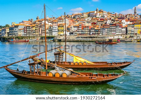 Cityscape of the city of Porto, Douro river with its old boat and its typical colored houses on the water's edge. Portugal. Europe.