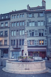 Cityscape of the old town of Geneva at blue hour. View of the Bourg-de-Four square and its fountain.