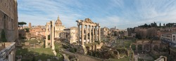 Cityscape of the Roman Forum ruins with the Arch of Severus, temple of Saturn, temple of Vesta, Basilica of Maxentius, Arch of Titus and Colosseum in Rome, Italy