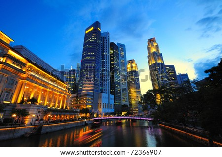 Cityscape of the Singapore financial district at dusk.