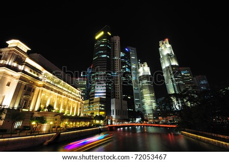 Cityscape of the Singapore financial district at night.