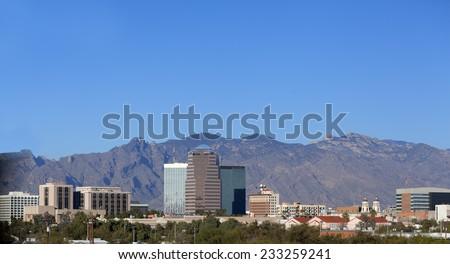 Cityscape of Tucson downtown against mountain range, Arizona