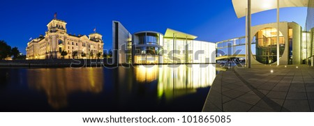 cityscape panorama with german government buildings and reichstag in berlin, germany, at night