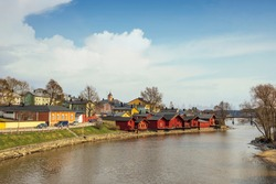 cityscape. Red wooden houses on the river bank in the city of Porvoo Finland  in the spring day