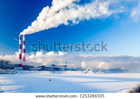 Cityscape - smoke of factory pipes pollutes atmosphere of the city. Concept of oil, coal, gas processing, pollution of environment, emissions into water resources, oncological diseases, cancer