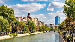 Cityscape view across Dambovita river city of Bucharest in autumn season in Romania