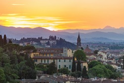 Cityscape view at Florence in evening light with the mountains