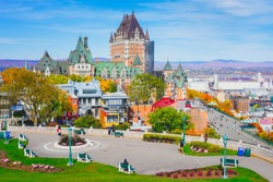 Cityscape view of Old Quebec City in Autumn, from hill close to fortification, famous viewpoint to see Chateau Frontenac, Dufferin terrace, St. Lawrence river. Beautiful landscape scene in fall season