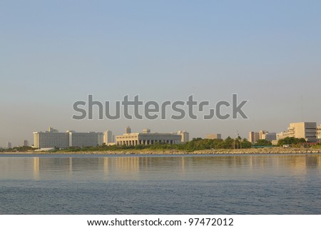 cityscape view with calm water in the foreground.