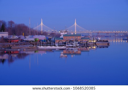 Cityscape with a bridge and riverboat pier in the early morning. Saint Petersburg, Russia. #1068520385