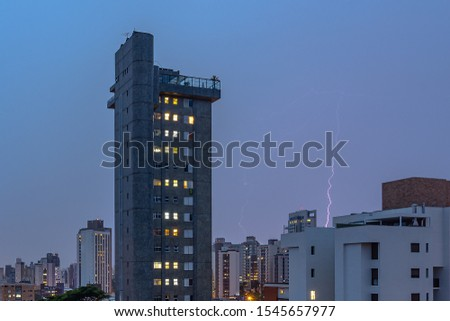 Cityscape with Buildings and a Stormy Sky with a Lightning Strike in Belo Horizonte, Minas Gerais State, Brazil