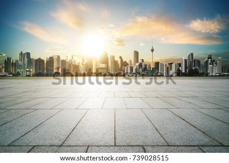 Cityscape with empty brick floor ,sunset sunrise scene .
