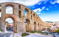 Cityscape with medieval aqueduct Kamares in the Kavala city, Macedonia, Greece.