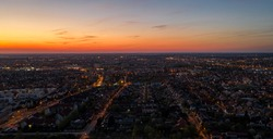 Cityscapes and city lights at goldenhour