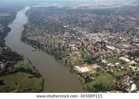 Shutterstock Ciudad del Este, Paraguay - aerial view with river Parana.