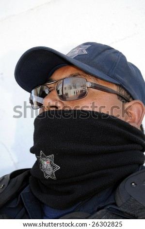 CIUDAD JUAREZ, MEXICO - FEB 27: A federal policeman waits for orders on February 27, 2009, in the violence-ridden border city of Ciudad Juarez, Mexico.