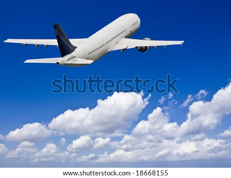Civil aircraft flying into deep blue skies with some cloud