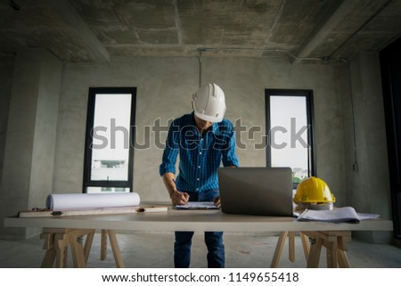 civil architech engineer choose color of building with laptop,engineering and architecture concept.Blue print is fake only for stock photo. #1149655418