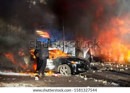 Civil conflict in society took the form of a violent confrontation between radical citizens of countries and the police and special forces, build barricades, burn tires and cars, throw stones ストックフォト ©