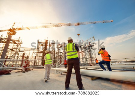 Civil engineer and safety officer inspection construction worker teamwork on scaffolding  election steel truss in construction site