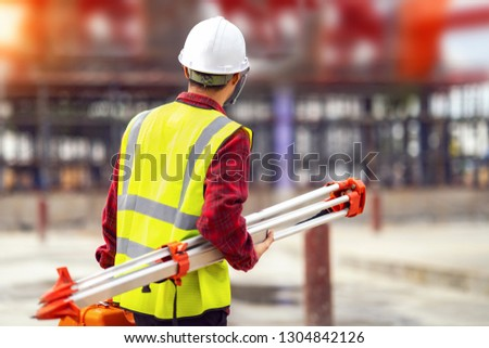 Civil engineer and survetor in building site with measure tool and construction background. this photo canuse for engineer, job, work and job concept #1304842126