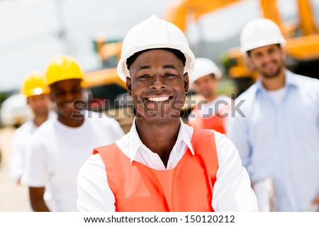 Civil engineer at a building site wearing a helmet