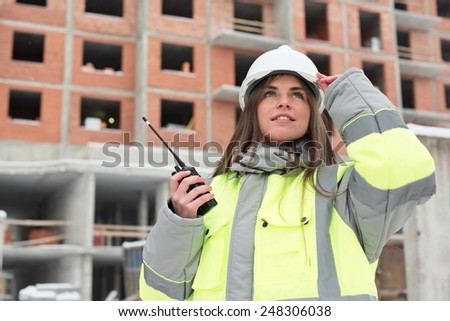 Civil Engineer at at construction site is inspecting ongoing production