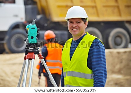 Civil Engineer Checking Surveyor equipment tacheometer or theodolite worker on the road.