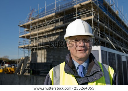 Civil Engineer With Construction Site