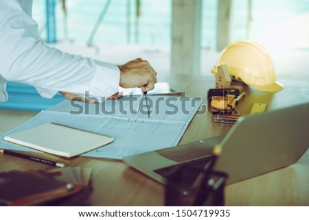 Civil engineer working at construction site. Engineering concept