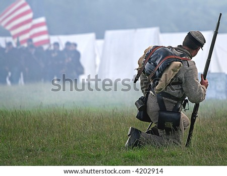 Civil War action as lone Soldier drops to knees to meet his fate as smoke from Muskets rises