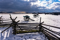 Civil War cannons in the snow at the Gettysburg National Military Park on the field of Pickett's Charge.