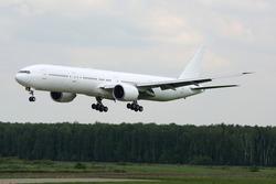 Civil wide-body passenger airplane landing at international airport.