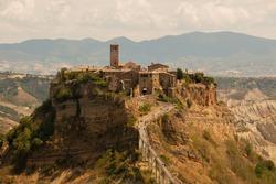 Civita di Bagnoregio, a typical medieval italian village, in a scenic tufa mountain's view.