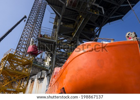ck up oil with almost fully leg up at shipyard at bow area