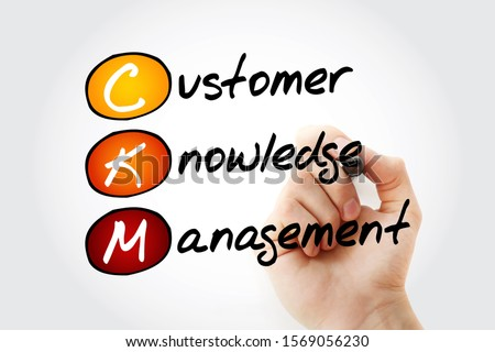 CKM - Customer Knowledge Management acronym with marker, business concept background