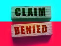 Claim denied on Wooden Blocks. Business financing sponsorship request concept, negative answer concept.