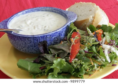 clam chowder soup and salad with bread