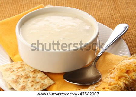 Clam chowder soup with crackers.