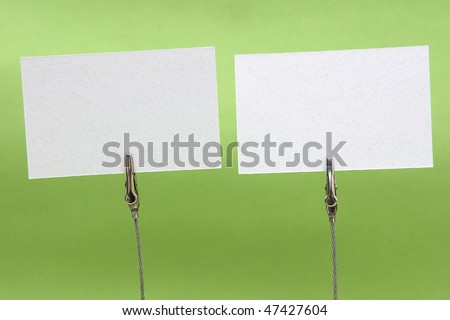 Clamp holding a blank card in green background