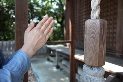 Clap the hands in prayer at a Shrine