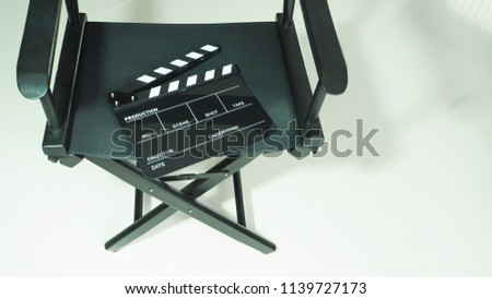 Clapperboard or clap board or slate with black director chair use in video production or movie ,film, cinema industry on white background.