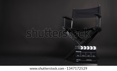 Clapperboard or movie slate with director chair use in video production or movie and cinema industry. It's black color.