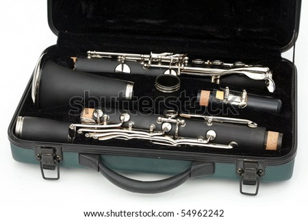 Clarinet broken down in its travel case Isolated on white